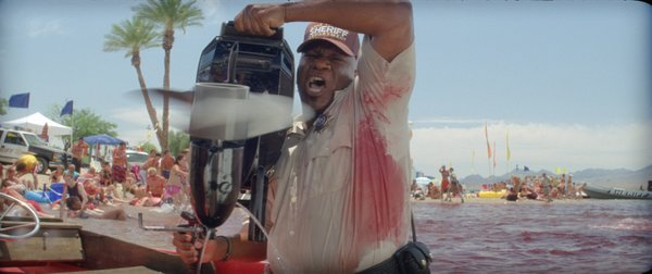 Ving Rhames goes medieval on those piranha... well okay not exactly.