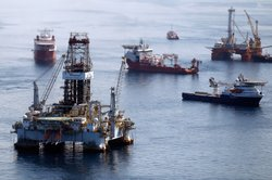 Ships work near the site of the BP Deepwater Horizon oil spill on August 3, 2...