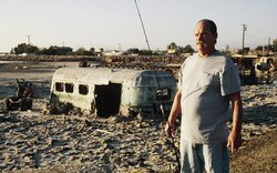 Resident Paul Clement standing near his trailer in Bombay Beach.