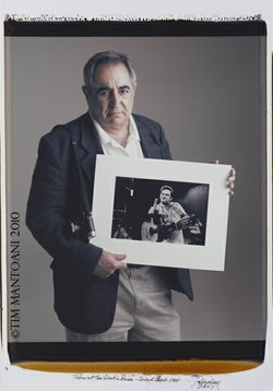 "Photographer Jim Marshall and his famous photograph of Johnny Cash. This image is part of Tim Mantoani's ""Behind Photographs Project."""