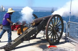 James Anderson from the Maritime Museum of San Diego lights a cannon on San D...