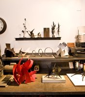Maquettes of Devine's work displayed in the studio.