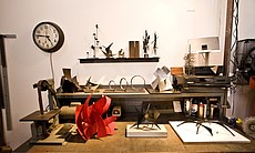 Maquettes of Devine's work displayed in the stu...