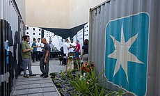 An outdoor courtyard in between the shipping containers serves as a space for mingling and, on Saturday, home to the bar and DJ for the evening.