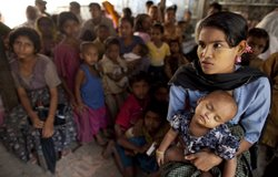 Residents of Sittwe, Myanmar wait in crowded room for their malaria test resu...