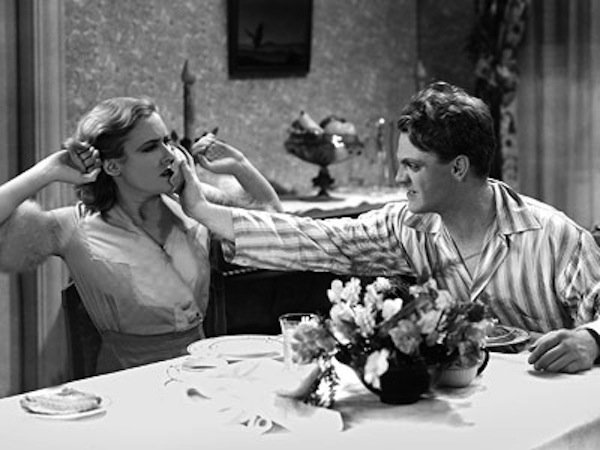 "James Cagney plants the infamous grapefruit in Mae Clarke's face in ""Public Enemy"""