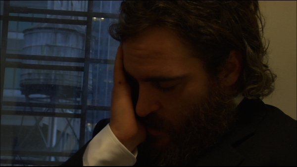 "Is the agony real or faked for teh camera? Joaquin Phoenix in ""I'm Still Here"""