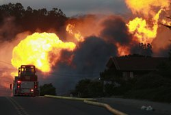 Flames from a massive fire are seen in a residential neighborhood September 9...