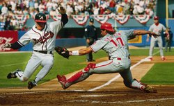 Jeff Blauser of the Atlanta Braves slides into home plate as the Philadelphia...