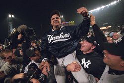 New York Yankees manager Joe Torre and Yankee players celebrate winning the 2...