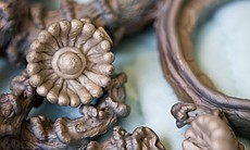Horn adds to the original design. In this piece, he added 60 of these bronze flowers to the design.