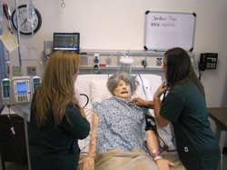 Grossmont College nursing students work with one of the computerized mannequi...