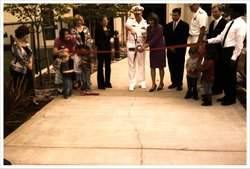 US Navy personnel and families gather for the ribbon-cutting ceremony at the ...