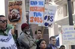 Demonstrators carry signs as they stage a protest demanding government action to create jobs outside of U.S. Sen. Dianne Feinstein's (D-CA) office on September 15, 2010 in San Francisco, California.