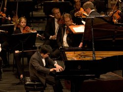 Gold Medalist (tie) Nobuyuki Tsujii (20 from Japan) performs with the Forth Worth Symphony Orchestra, under the direction of Maestro James Conlon, during the finals of The Thirteenth Van Cliburn International Piano Competition in Fort Worth, Texas (2009).