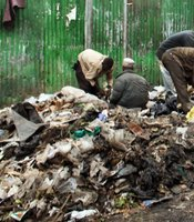 Men dig through a refuse dump in Eastleigh, a predominantly Muslim Somali neighborhood on August 18, 2009 in Nairobi, Kenya. Referred to locally as 'Little Mogadishu', Eastleigh is home to thousands of Somalis who have fled war-ravaged Somalia in recent years.