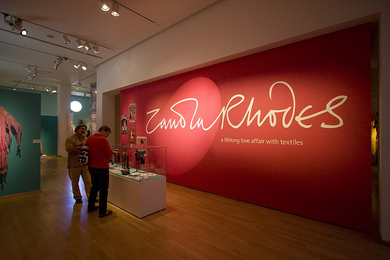 The Mingei exhibit opens with a wall of Rhodes signature pink.  The retrospec...
