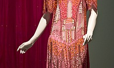 A Zandra Rhodes design from the 1985 Manhattan Collection.  The dress was inspired by the Manhattan landscape and features the Empire State and Chrysler buildings.