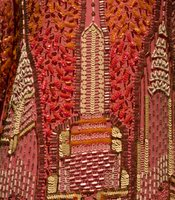 A detail of the Manhattan skyline featured on the dress.  It is a hand-beaded dress, made with sequins and bugle beads.