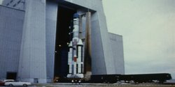 The giant Titan III rocket is prepared for launch. Atop Titan III is an empty Gemini B capsule. This launch was the first unmanned test launch of the Manned Orbiting Laboratory (MOL). The test launch was a success.