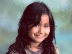 This photo provided by the National Center for Missing and Exploited Children shows Elisa Cardenas, 8, of Fresno, Calif.