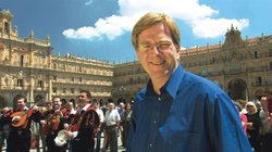 Rick Steves and a Tuna Band in Salamanca, Spain.