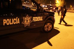 Mexican police investigate a violent drug-related crime scene on March 21, 20...