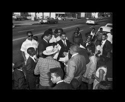 Muhammed Ali signing autographs in San Diego. Photographed by Norman Baynard.