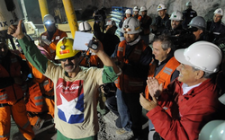 Chile's President Sebastian Pinera, front right, hugs rescued miner Florencio Avalos after Avalos was rescued from the collapsed San Jose gold and copper mine where he was trapped with 32 other miners for over two months near Copiapo, Chile.