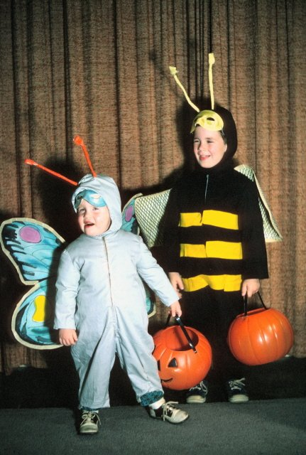 "Renee Owens sent me a number of her childhood costumes and they are too cute to not share. This is her and her brother Derek as bugs. Renee wrote in her email: ""Why my parents always had us stuff our costumes with pillows to look fat, I'll never know, but when I was a butterfly, that IS a pillow in my costume."""