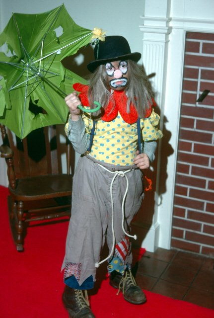 "Derek Owens (Renee's brother) as a clown. Renee writes, ""I think he was really NOT happy with being a clown (not cool enough), no makeup needed for the frown."""