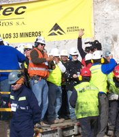 """""""Plan B"""" team celebrating on breaking through to the miners on Saturday, October 9, 2010, San José Mine, Copiapo, Chile."""