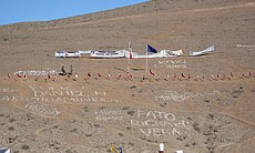 Hillside with flags and families messages, San ...
