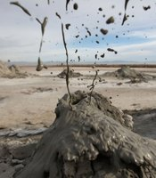 Mud flies as carbon dioxide gas from deep underground fissures escapes through geothermal mudpots, or mud volcanoes, over the southern San Andreas earthquake fault near the Salton Sea National Wildlife Refuge on January 16, 2010 near Calipatria, California.