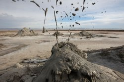 Mud flies as carbon dioxide gas from deep underground fissures escapes throug...