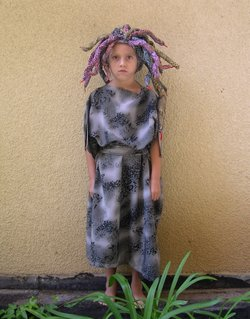 "Halloween 2005. Sophia as Medusa. While on vacation in the summer of 2005, the Grecos bought one of their favorite books, ""Mythological Monsters of Ancient Greece"" by Sara Fanelli. When they returned home, they went to the library and eventually read all about the Greek myths. Soon after, Sophia decided that she would like to be Medusa for Halloween. This costume is made out of thrifted fabrics, felt and wire."