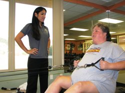 : Physical activity specialist Angelina Renteria watches over Jackie Withers ...