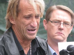 Jim Witham, 52, breaks down during a news conference while recalling sexual a...