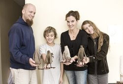 Rob, Enzo, Lizette and Sophia Greco holding plush toy headless pigeons made f...