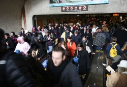 Crowds of people stream out of the Capitol South metro station January 19, 20...