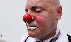 Close-up photo of Glen Heroy dressed in clown m...
