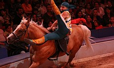 Equestrian acrobat Sultan Kumisbayev performing for the audience