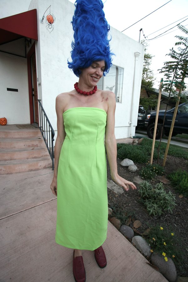 Rachel Rath as Marge Simpson. She bought the wig in an after-Halloween sale for $10, then made the dress and necklace for the following year.