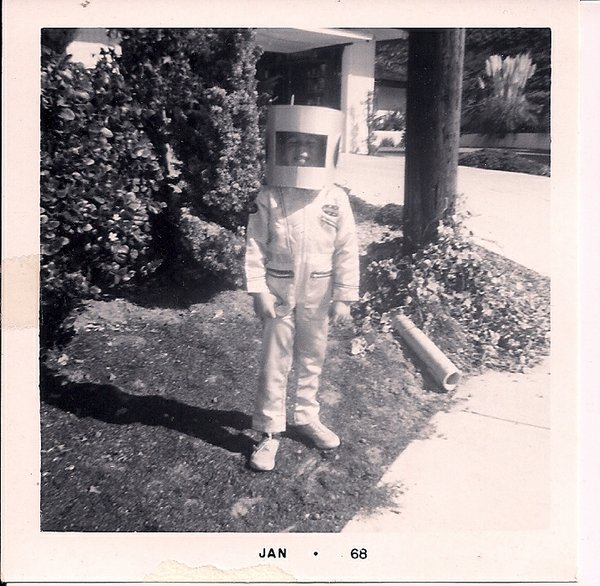 "This is adorable! Joe Stagg in his favorite costume, as an astronaut. He says:  ""It was the height of the Space Race,™ and my mom made the helmet out of a Baskin-Robbins tub, then sprayed it (and my sneakers) silver. You can tell by the date stamp that I didn't just wear it on that one special night."""