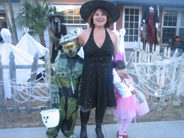 KPBS Station Manager Deanna Mackey and her two kids from last year's Halloween. Kristine is a princess and Robert is the master chief from Halo.