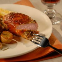 prosciutto-wrapped pork chops with pan-roasted rosemary potatoes