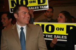 Carl DeMaio smiles with his supporters who are against Proposition D at Golde...