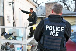 ICE officers during a deportation raid. Photo Courtesy of ICE.