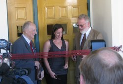 Ambassador Charles Hostler, Ericka Korb, President of the Student Veteran Organization and SDSU President Stephen Weber cutting the ribbon to the new Veterans' Center on Campus.