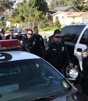 Police officers process to the funeral of slain officer Christopher Wilson at the Rock Church in San Diego, Calif. on November 4, 2010.